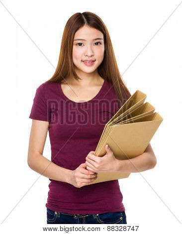 Young student holding lots of folder