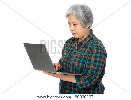 Old woman with a notebook