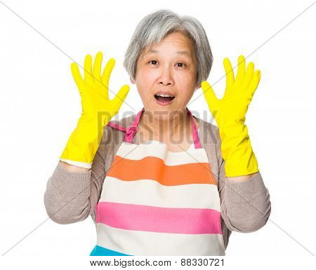 Excite housewife with plastic gloves and raise hand up
