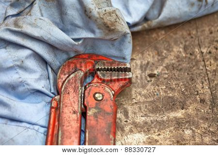 Adjustable wrench closeup in a workshop