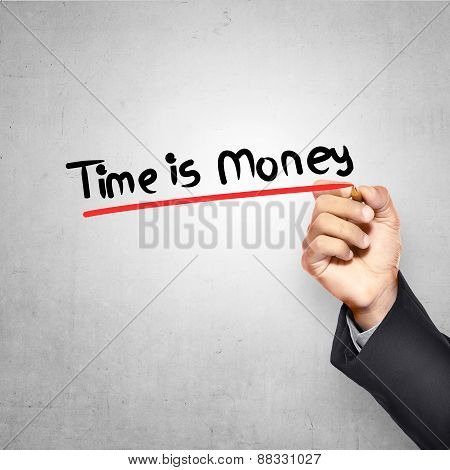 Man Writing Time Is Money Text