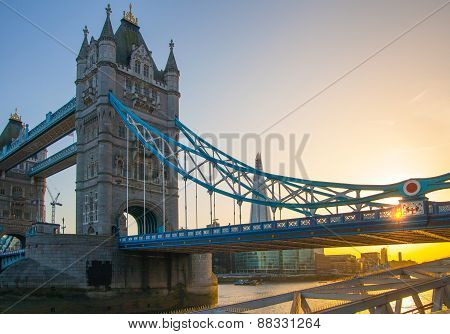LONDON, UK - APRIL15, 2015: Tower bridge in sunset. City of London, south bank of river Thames walk.