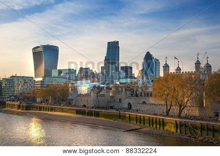 LONDON, UK - APRIL15, 2015: City of London and Tower on the river Thames in sun set light