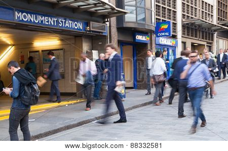 LONDON, UK - APRIL15, 2015: City of London, tube commuters walking in front of London's tube station