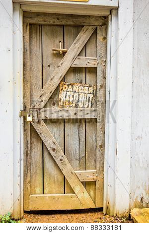 Old Wooden Door With Danger Sign