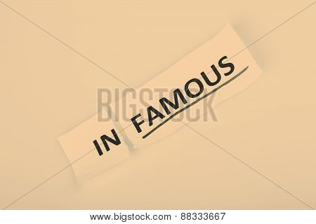 The word infamous changed to famous on torn paper and white background
