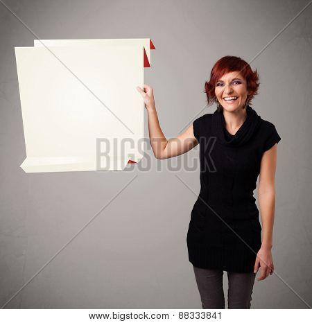 Baeutiful young woman holding white origami paper copy space