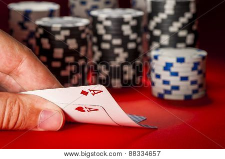 Poker Game. Man's Hand With A Pair Of Aces