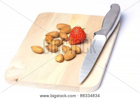 Strawberries And Almonds On Chopping Block