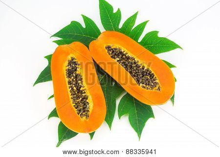Haft Cut Papaya Fruit And Papaya Leaf Isolated Over White Background