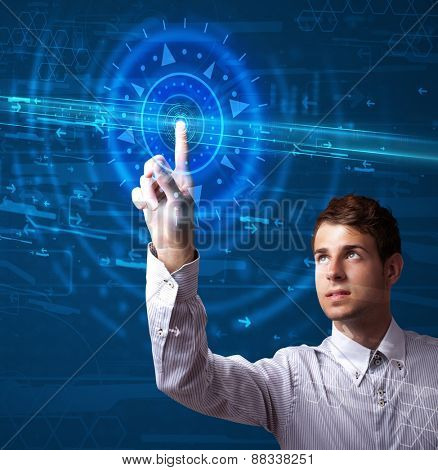 Tech guy pressing high technology control panel screen concept
