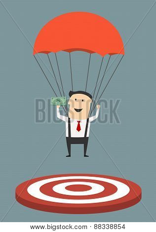 Businessman with parachute landing on target