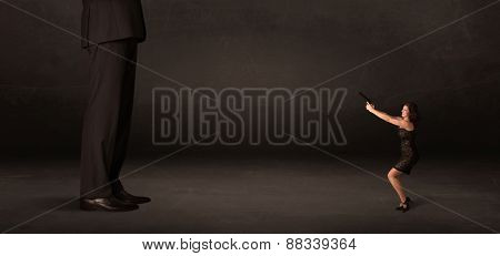 Huge man with small businesswoman standing at front concept on background
