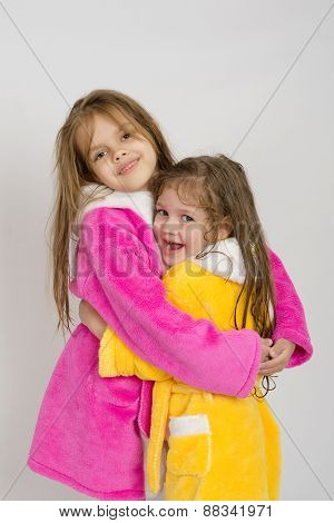 Girls In Pink And Yellow Robe Hug