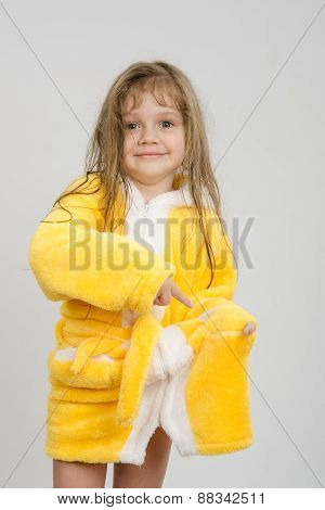 Girl Pointing To A Hole In The Pocket Of His Robe