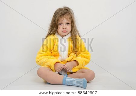 Offended Girl In Yellow Bathrobe