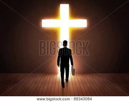 Man looking at bright cross sign concept