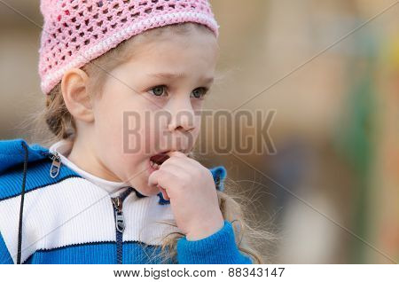 Girl In Thought Stuck A Finger Her Mouth