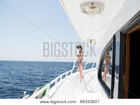 Beautiful Young Woman In Sun Glasses On Yacht, Open Sea