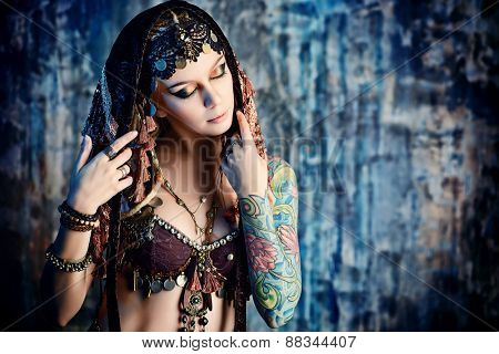 Art portrait of a beautiful traditional female dancer. Ethnic dance. Belly dancing. Tribal dancing.