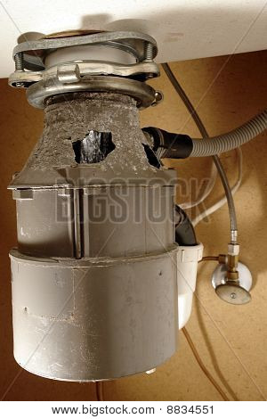 Damaged Household Food Waste Garbage Disposal Appliance