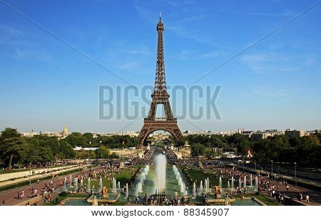 People Relax Near The Eiffel Tower And Fountains