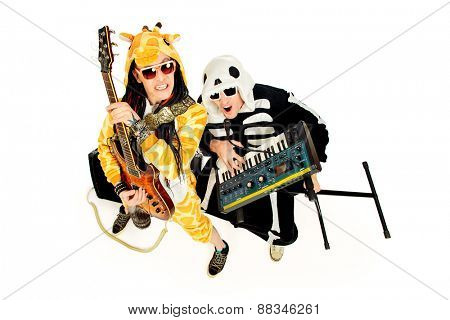 Rock band in costumes of  skeleton and giraffe playing the synthesizer and electric guitar and singing. Music show. Halloween. Isolated over white.