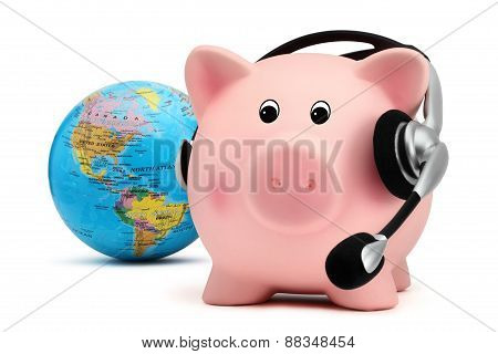Piggy Bank With Headset And Globe Isolated On White Backround
