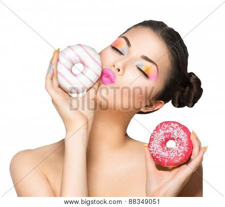 Beauty fashion model girl taking sweets and colorful donuts. Funny joyful Vogue styled woman choosing sweets isolated on white background. Diet, dieting concept. Junk food, Slimming, weight loss