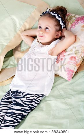 Girl is lying on the bed and dreaming