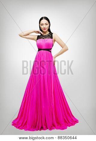 Long Dress, Young Fashion Model In Pink Gown High Waist, Woman In Beauty Clothes Isolated Over Gray