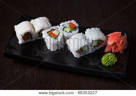 Rolls on a black plate