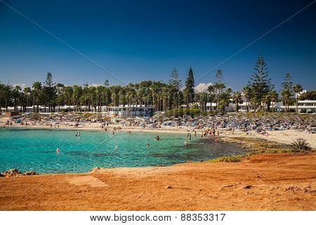 People Relaxing At Nissi Beach In Cyprus