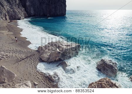 Woman looks at the sea in the island Lefkada, Greece.