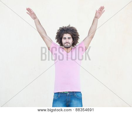 Young handsome man with open arms