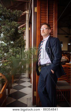 Pensive businessman in restaurant