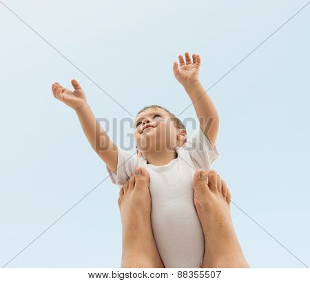 Parenting happy baby holding in air