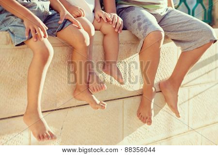 Group of happy children feet