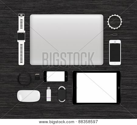 Top View Of Tech Gadgets Mock Up For Branding Identity On Black Desk Surface