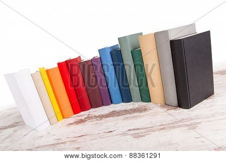 Isolated Row Of Different Books In Different Colors.