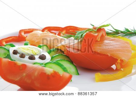 diet food - smoked sea salmon with vegetables on plate isolated over white background