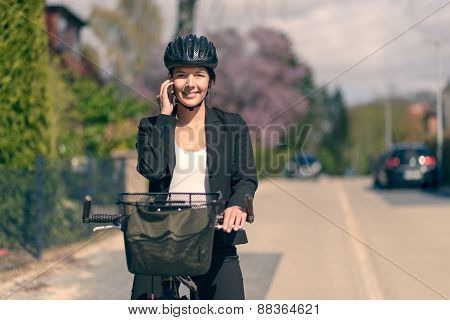 Businesswoman Riding To Work Pausing For A Call