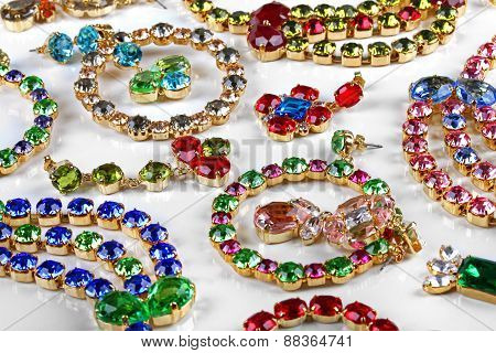 Variety Of Gemstone Jewelry On White Table