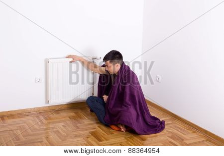 Man With Blanket Beside Radiator