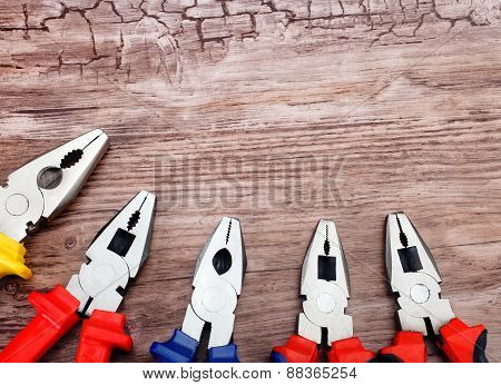 copyspace image set of pliers on wooden board