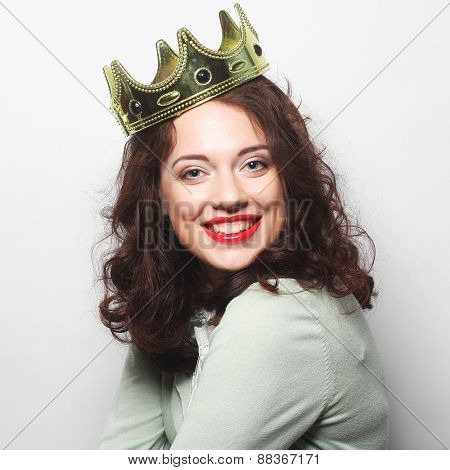 young lovely expression woman in crown