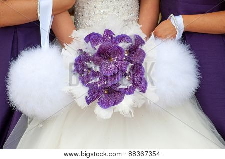 Bride And Bridesmaids With Purple Orchid Bouquet