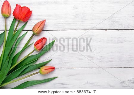 Red Tulips Bouquet On Wooden Background. Top View, Copy Space.