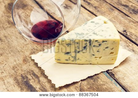 Blue Cheese With Overturned Glass Of Wine