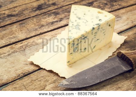 Blue Cheese On Old Paper With Rural Knife